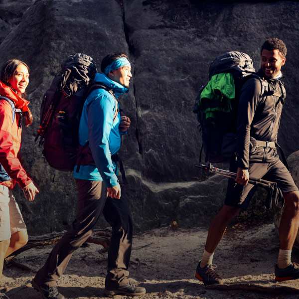 Three hikers with large packs
